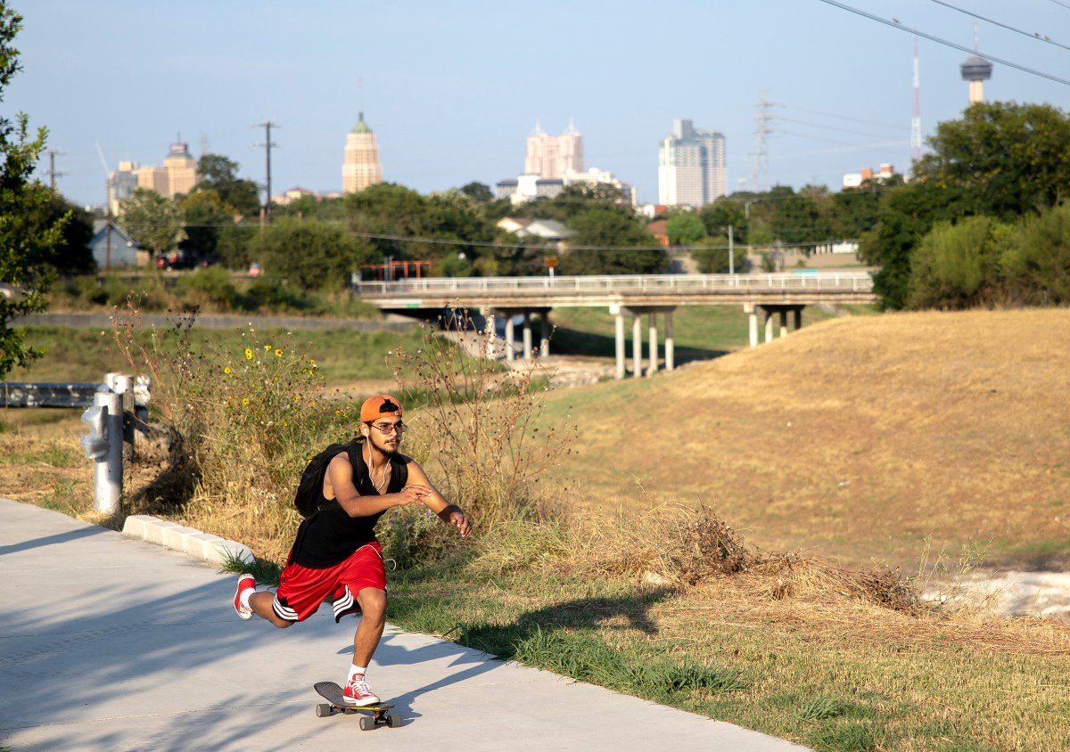 A man skateboards on the Apache Creek Trailway on Wednesday.