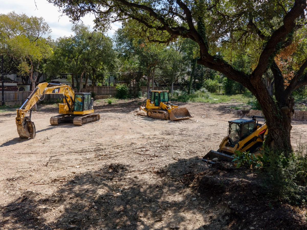 Construction equipment remains on a lot where a midcentury modern home once stood in Olmos Park on Thursday.