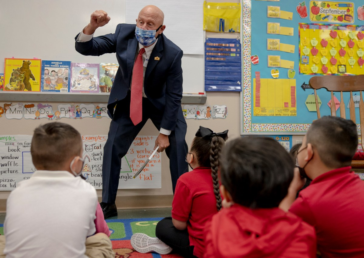 Dr. Robert Jaklich, SAISD's interim superintendent, makes a pinky promise with kindergartners to work hard at Wilson Elementary on Thursday.