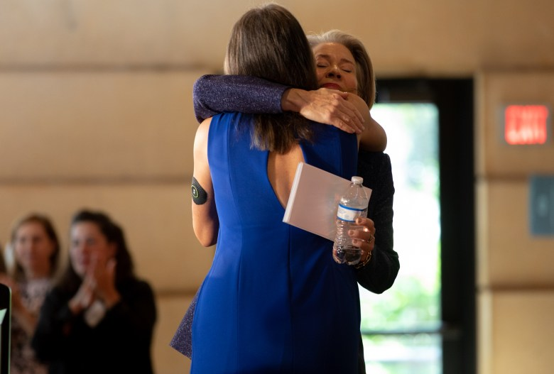 Planned Parenthood South Texas Board Chair Elise Boyan embraces luncheon co-chair Joan Wyatt, right, during the annual luncheon.