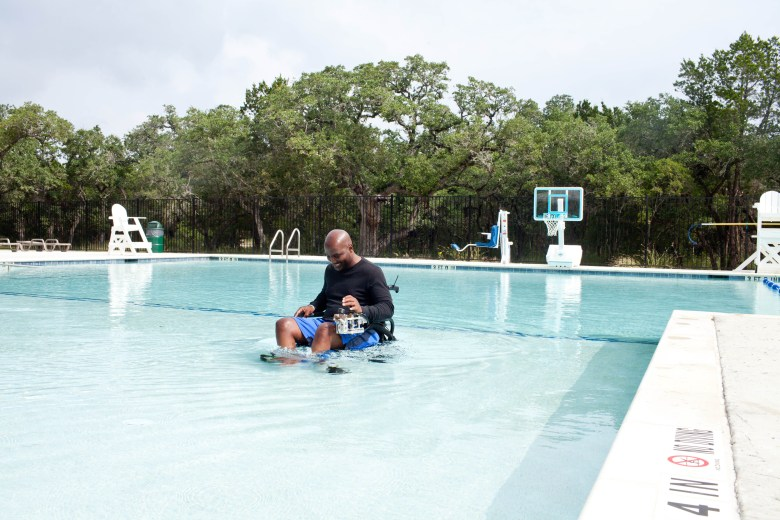 Mario Wright uses a pneumatic wheelchair in the pool at Morgan's Wonderland Camp.