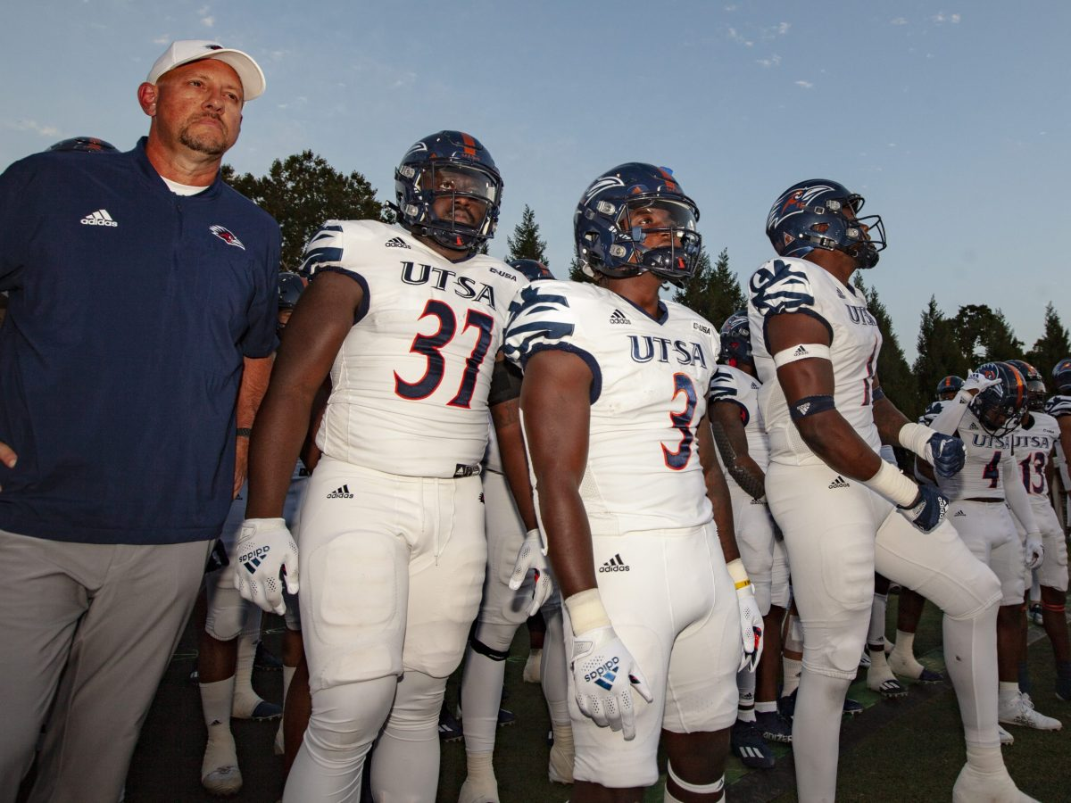 UTSA head coach Jeff Traylor stands with his players before the start of UTSA's 52-46 win over WKU on Saturday, Oct. 9, 2021, at Houchens-Smith Stadium.
