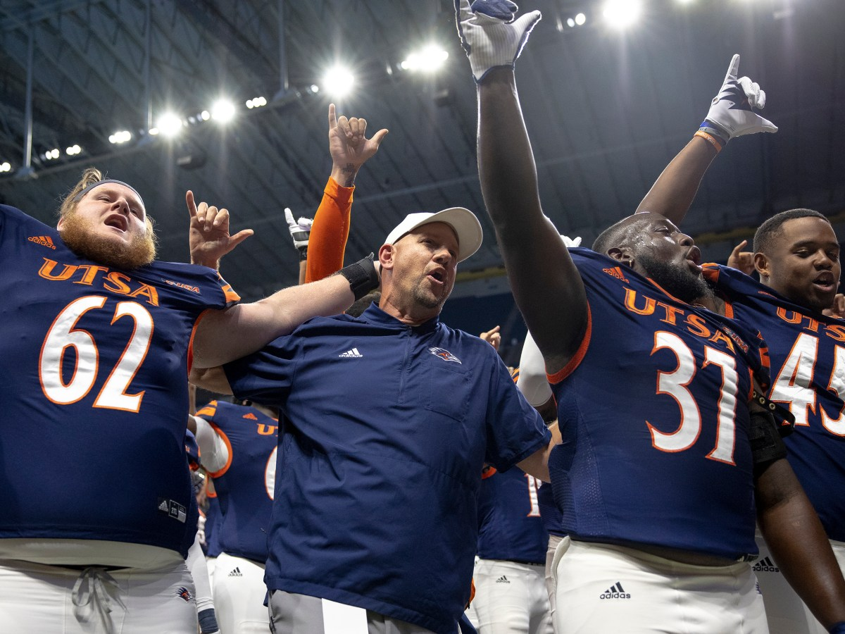 UTSA coach Jeff Traylor celebrates with players after UTSA defeated Rice 45-0 in a college football game at the Alamodome on Saturday.