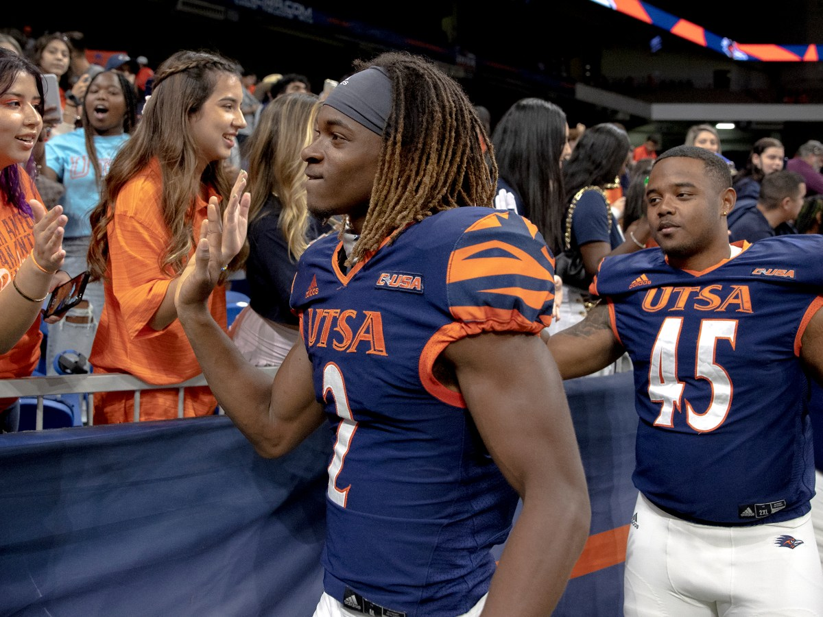UTSA wide receiver Joshua Cephus (2) high fives fans after UTSA defeated Rice 45-0 in a college football game at the Alamodome on Saturday.