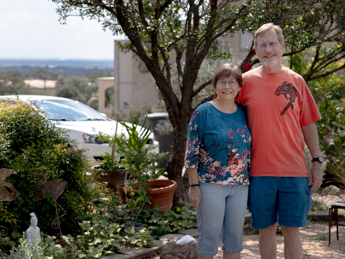 Linda and Michael Richter stand in their front yard which they xeriscaped to avoid the upkeep of a lawn.