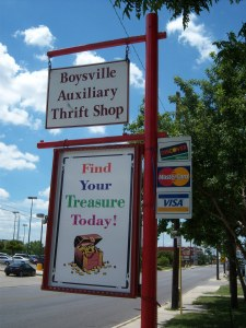 Photo of the sign outside of the Boysville Thrift Store on West Olmos Drive.