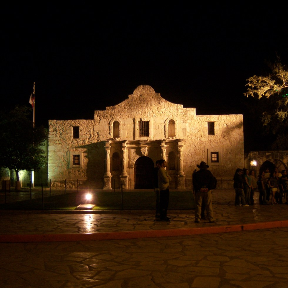 Photo of The Alamo at night.