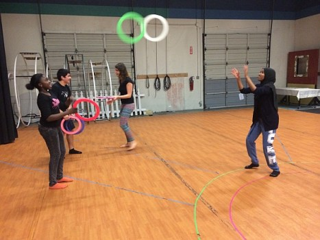 Youth from ReWA learn to juggle and pass rings.