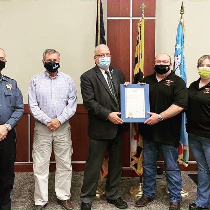 Copy of the Washington County, Maryland Second Amendment Sanctuary Resolution being presented to Tim Hafer of Hafer's Gunsmithing.