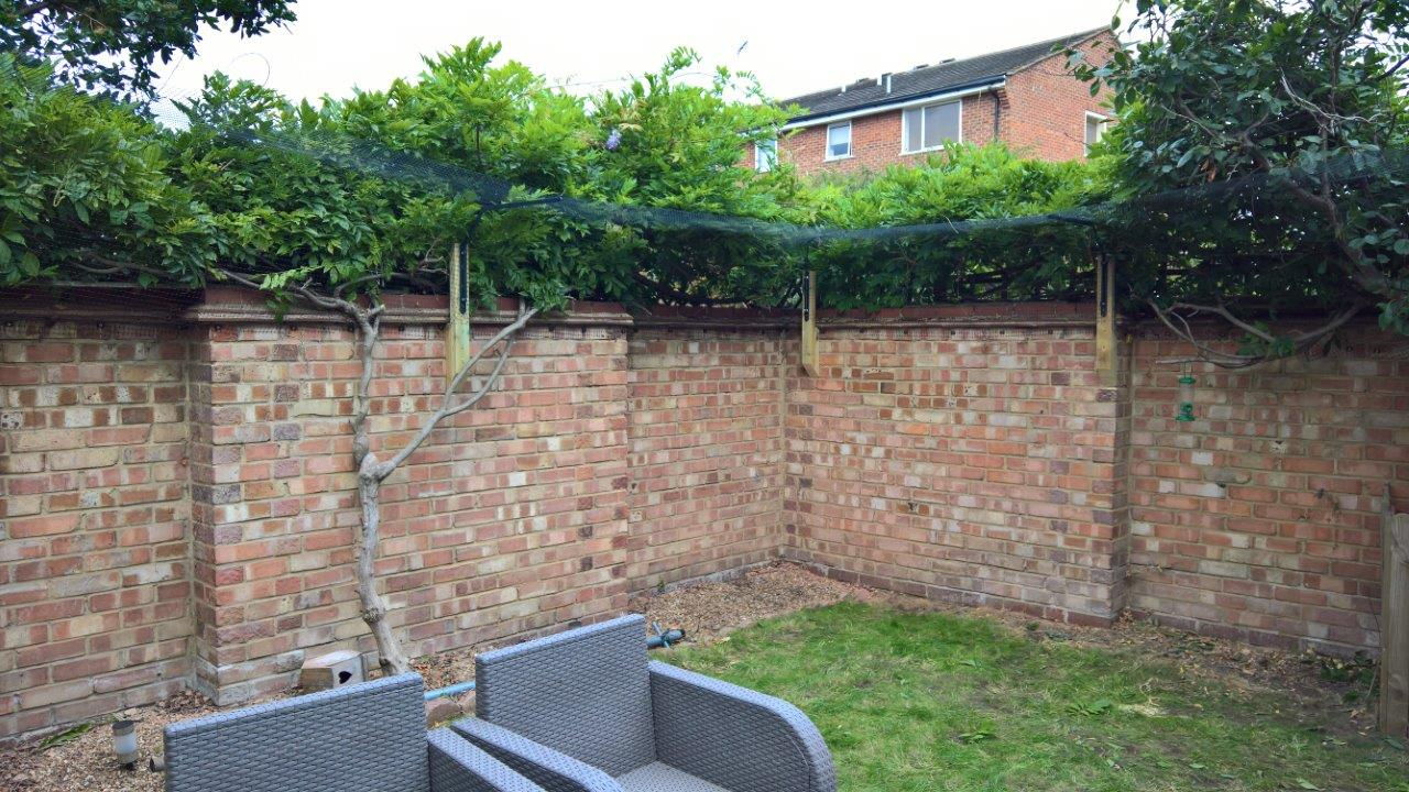 Cat proof fence attached to wall