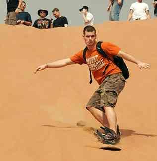 Sand snowboarding (sandboarding)