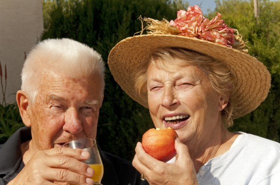 old couple eating apple