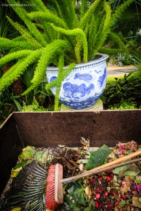 broom and rake with chinese vase in the greenhouse