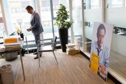 De Wever checks his phone