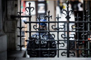 Brussel Belgium 20 november 2015. Europe under terrorist threat. The Big Square of Brussels was closed for everyone this morning. A policeman seen through a very old typical metal Belgium fence.