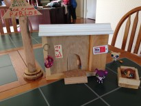 store front w/sign and crib