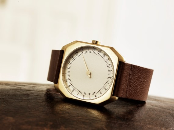 slow Jo gold case brown leather by slow watches on sofa