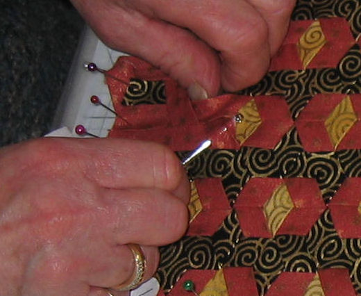Using the bodkin to weave the strips