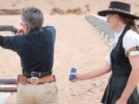 Texas Tiger timing Heidi as she shoots a cowboy action stage