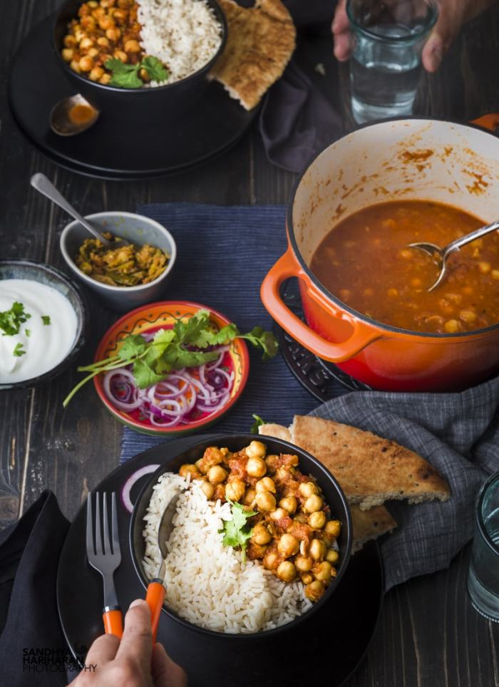 black bowl filled with rice and chana masala