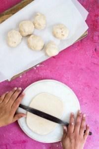 roll the dough into a circular disc shape