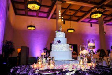 The-Prado-San-Diego-cake-pinspot-lights-with-purple-uplights