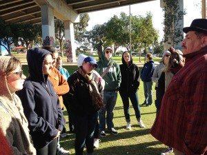 Chicano Park muralist Victor Ochoa engages Loyola students.