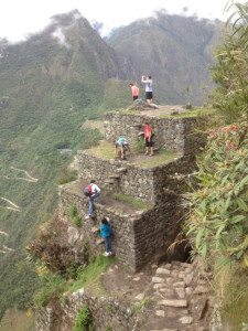 People climbing the Inca built plateau.