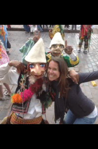 Jenny and some parading Cuzco locals.
