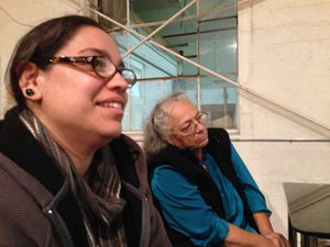 Olympia Beltrán and her mom Glo Andrade listen in on the anti-referendum discussion.