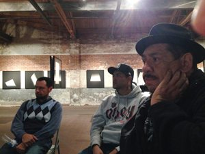 Meeting attendees Javier, Cesar and Victor focused on the discussion.