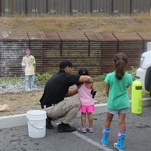 Border Patrol agents teaching children how to shoot undocumented border crossers.