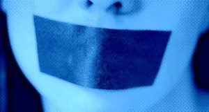 Close-up of a young woman with adhesive tape over her mouth