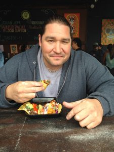 Ernie Pio Becerra chowing down on one of his taco creations.