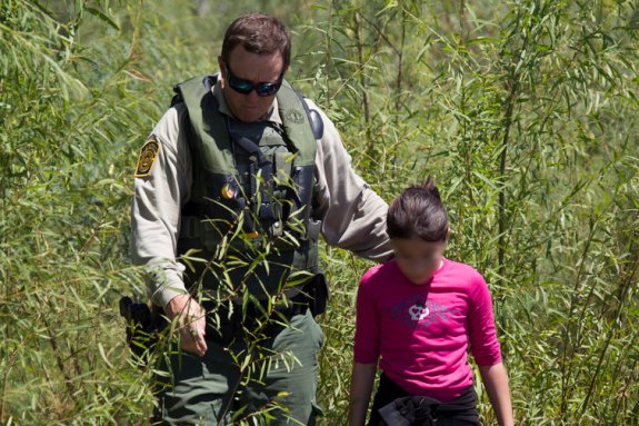 Border Patrol rescues immigrant girl stranded on banks of Rio Grande. Photo by Donna Burton. US Customs and Border Protection on Flickr, Creative Commons license