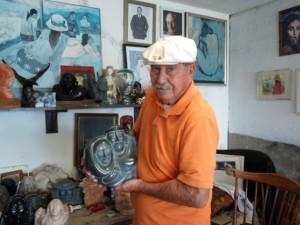 Paul Torres with sculptures