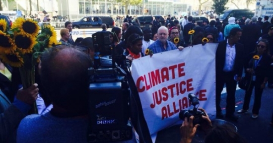 "Community leaders from Our Power Campaign attempt to deliver a statement to the UN but are denied entry. They brought ""representing our community-led solutions, as plants that clean the soil of toxics,"" according a group statement. (Photo: Climate Justice Alliance)"