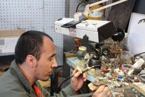A craftsman applies his trade.