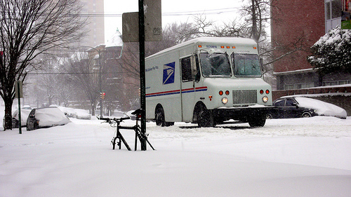 USPS truck in snow