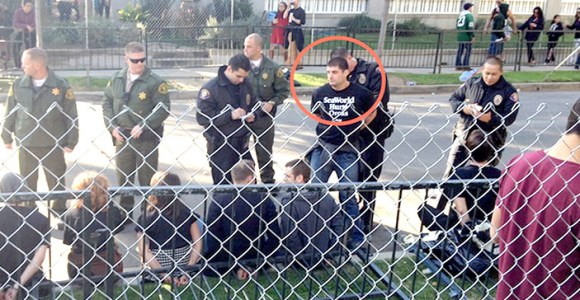 PETA says this photo of 2014 Rose Parade arrest shows Paul McComb of SeaWorld, who went by Thomas Jones. (Via Times of San Diego)