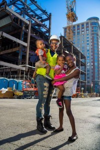 construction worker and he family at downtown construction site