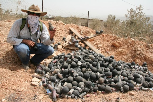 My colleague Patrick by a collection of expended grenade canisters that have been used against Palestinians during weekly protests in Bil'in, West Bank.