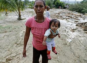 A mother and her daughter evacuate the town of Laur, Nueva Ecija, Philippines