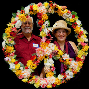 Jeeni and Juan framed by floral peace sign