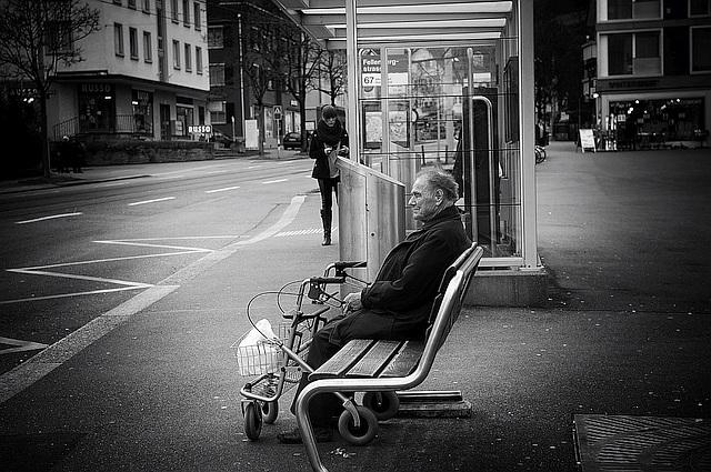 Elderly man sitting on bench