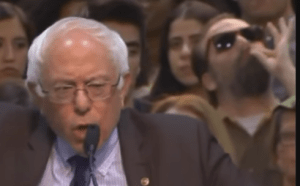 The guy in the sunglasses approves of what Sanders was talking about...