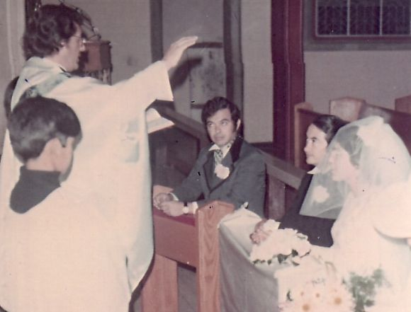 Father Juan Hurtado blessing the couple