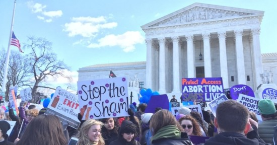 """Women protest outside the U.S. Supreme Court on Wednesday against """"sham"""" abortion laws that have threatened their health and autonomy. (Photo: NARAL Pro-choice NC/Twitter)"""