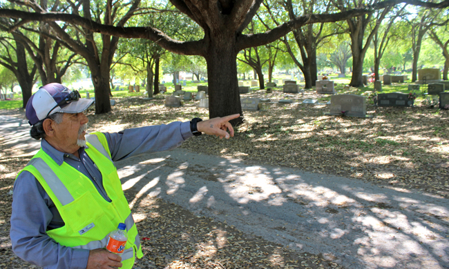 Juan Manuel Villareal points to where a fence once divided the white dead from the Tejano dead. Photo by Roberto Lovato.