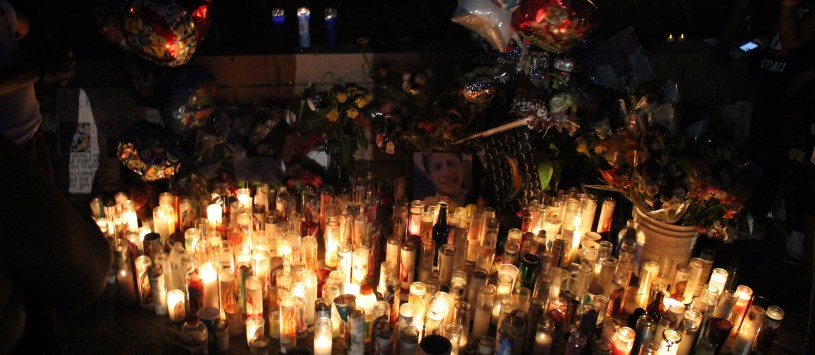 Votive candles at vigil for Jonathan Cortez